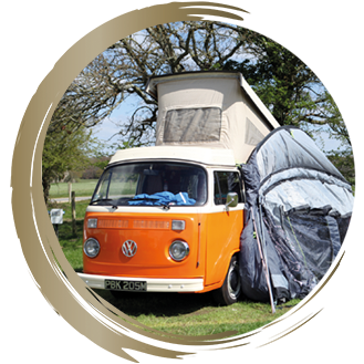 A campervan pitched up at Long Meadow Campsite